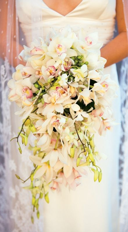 Cascading Tropical Bouquet with Orchids #wedding Although I'd prefer a brighter bouquet like the look though