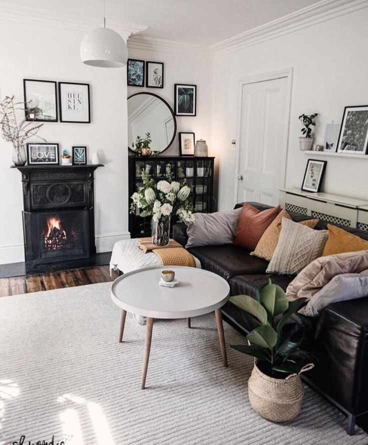 Masculine Mid Century Modern Living Room Decor With Black Fireplace And Black Le In 2020 Eclectic Living Room Leather Couches Living Room Cosy Living Room