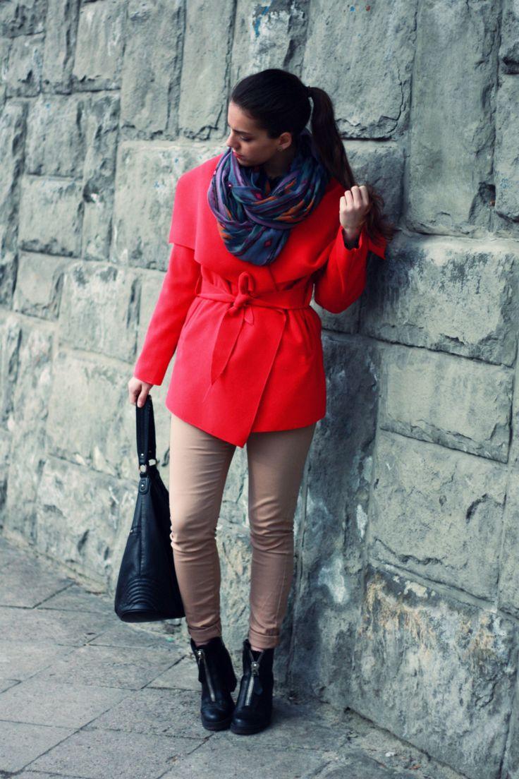 Pink coat and beige pants.