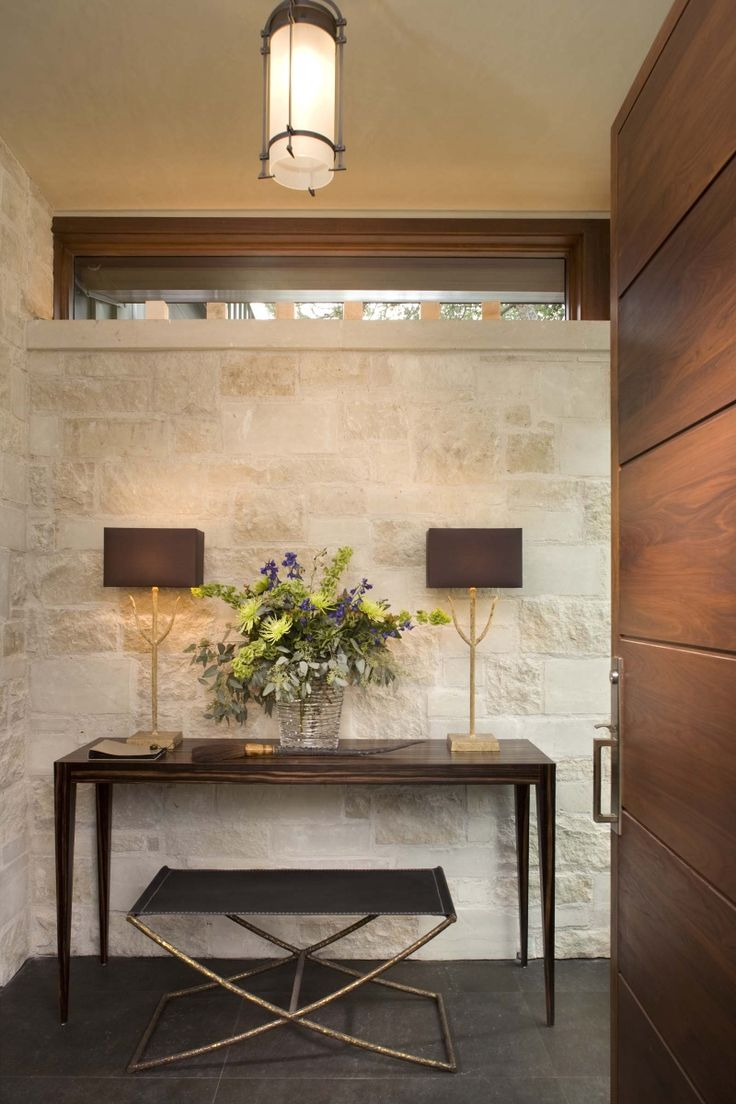 Amazing Interior Wall With Stone An Exterior Wall Of Cut Limestone Pierces Through  The Facade Of The House And Contin Ues Into The Entry. A Granite Stone  Floor And ...