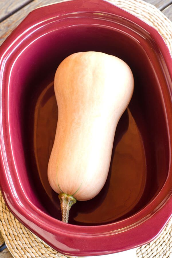 Crock pot butternut squash: How to cook a whole butternut squash the easy way — without cutting it up first. ~ http://cookeatpaleo.com