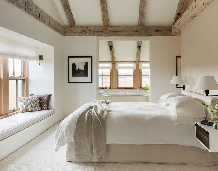 "The master bedroom is scaled for two, and connects the couple with the surrounding land. The custom slip covered bed and natural lines are never supposed to look perfect,"" says Walsh. ""The messier the better."