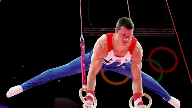 Kristian Thomas of Great Britain competes in the rings in the Artistic Gymnastics men's team qualification on Day 1 of the London 2012 Olympic Games at North Greenwich Arena on 28 July.