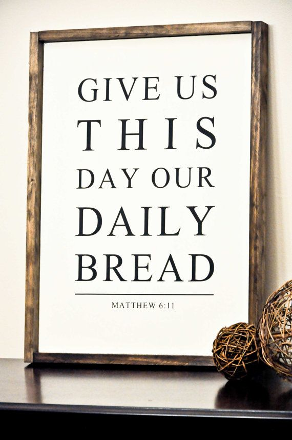 Give us this day our daily bread. Matthew 6:11  This listing is for our READY TO SHIP framed wood sign.   Dimensions for the sign shown are approx. 25.5 x 18.75 inches.   Background Color: Off White Text: Black Frame: Dark Walnut Stain  The frame gives this gorgeous sign a popular farmhouse/rustic feel.  All signs are PAINTED with absolutely NO VINYL on the finished product to prevent from deteriorating over time. Each sign is made individually by hand, therefore, may slightly show distr...