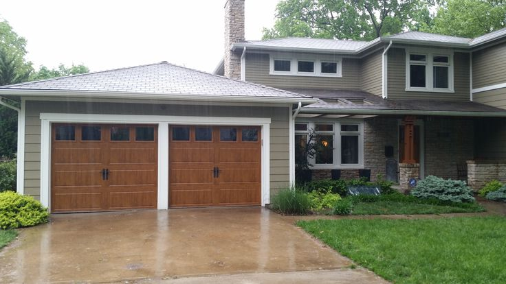 67 best wood look garage doors without the upkeep images for Wood look steel garage doors