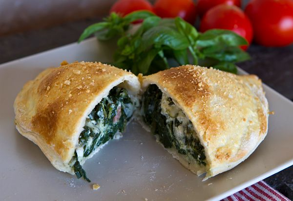 Spinach Calzone with Bacon, Parmesan & Mozzarella http://www.italianfoodforever.com/2012/09/spinach-and-ricotta-cheese-calzone/