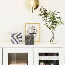 Modern chrome design wall lamp in front of mirror Gloria - Malin Lundmark