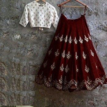 The beautiful blend of maroon and white is exhibited in this lavish designer lehenga. Buy it right away. #unfoldethnicfashion #casualwear #indianwear