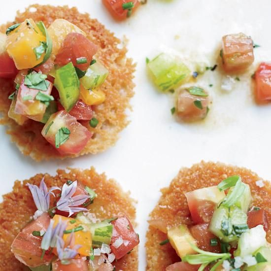 Parmesan Tuiles with Heirloom Tomato Salad | Chopped red, green and orange tomatoes are tossed with olive oil and herbs, then served on Parmesan tuiles. The result: a supremely colorful, incredibly easy hors d'oeuvre.