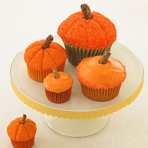 Frosted pumpkin cupcakes.
