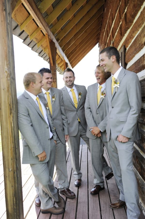 The guys in gray suits and yellow ties... love it! Just add pink/green boutineers instead of yellow :)