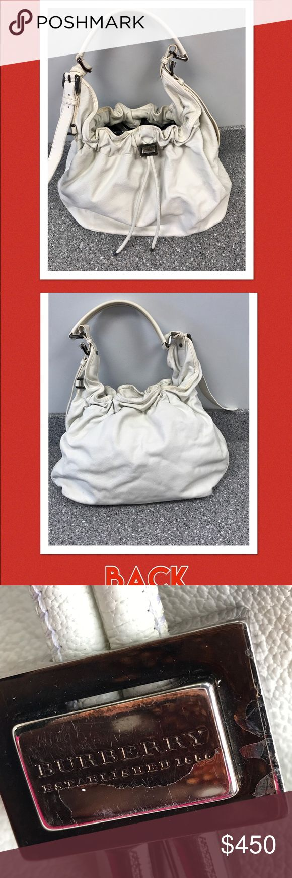 Burberry offwhite large drawstring hobo handbag Burberry authentic butter soft leather off white soft large drawstring handbag . The leather and hardware is fabulous !! The inside is super clean . I lost the dust bag . The bottom has brass protective feet all intact . Size -19 inches across by 12 inches high by 13 inches deep .The Burberry silver pull has discolored but can be shined .slight yellowing under the strap and one place on the trim from sitting in my closet needs cleaning with…