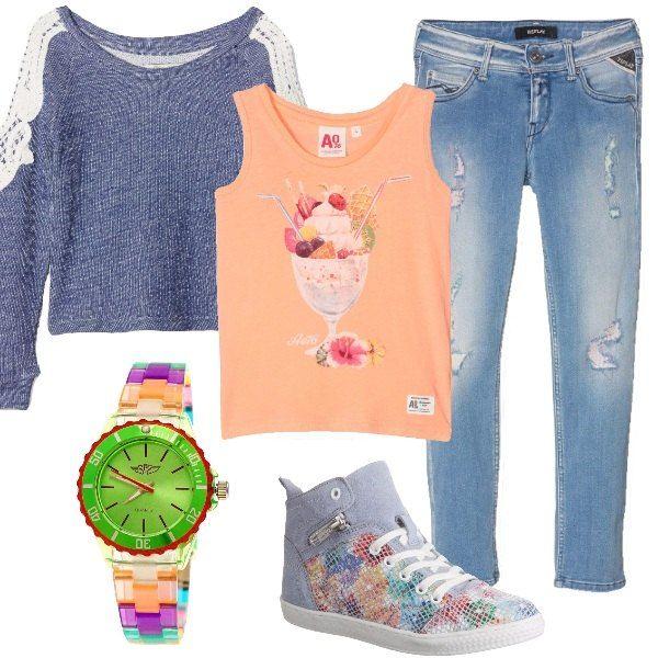 Bella e comoda con questo look davvero trendy. Jeans con strappi abbinato a splendida t-shirt arancione con stampa e a felpa blu. Sneakers alte e orologio colorato completano il tutto.