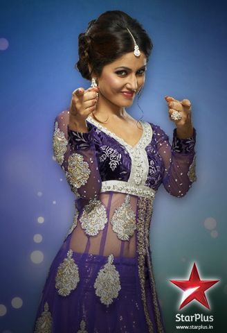 Akshara looks pretty in purple embroidered dress.