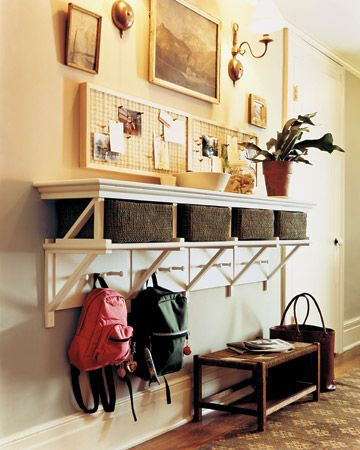 """Basket Rack How-To: Each family member gets a woven storage basket and a trio of Shaker-style pegs. Two sizes of wooden brackets support the long shelves. The top set, turned upside down, forms cubicles for the baskets; the larger bottom set frames four poplar boards fitted with the pegs."""