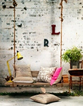 Industrial | Eclectic | Pops of color | Plant- touch of greenery | Indoor/Outdoor feel | Suspended chair/bench | Mismatched Cushions | Outdoor living