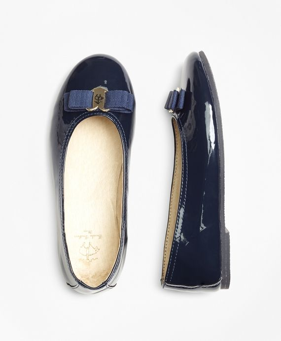 Our flats are crafted in patent leather with a heart design and ribbon at the toe. Imported.
