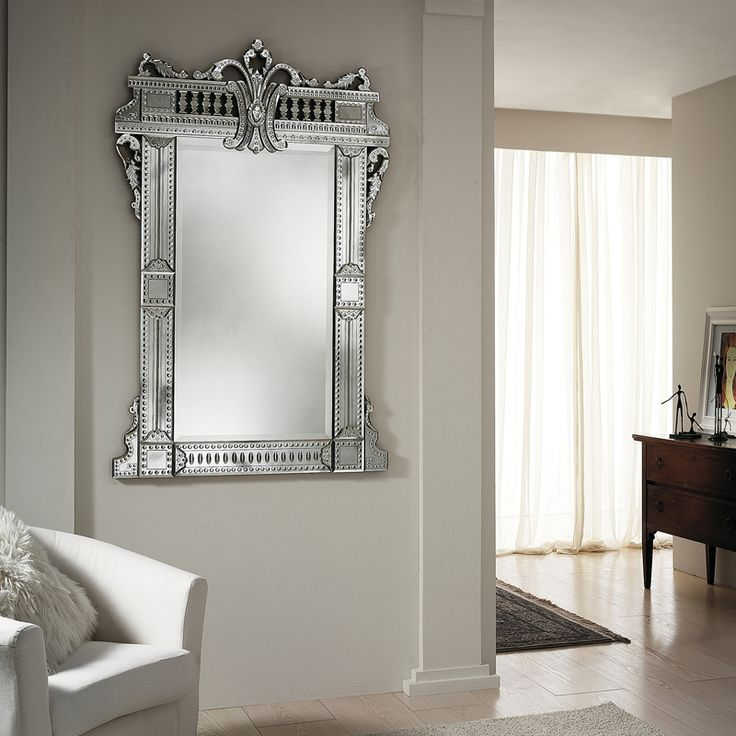 7038 Hand bevelled and engraved antiqued mirror in French style. Structure in antiqued solid natural wood.