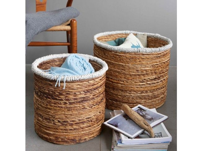 Two sizes of lovely round baskets made from abaca fibres - also known as Manila Hemp. Both sizes have a million and one uses all round the home. With an attractive white detail round the top, these unique baskets really stand out from the crowd. #livingroom #Storage