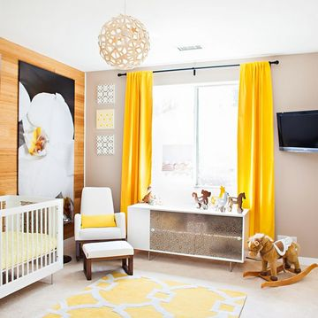 With the help of celebrity nursery designer Vanessa Antonelli, the reality star and former Playboy bunny chose gender-neutral yellow as the prominent color for her daughter Alijah's nursery—but in a bright, sunshine shade as opposed to the usual pale version. The cheery room also features a mirror-front cabinet and giant orchid painting for some sophisticated, grown-up touches.