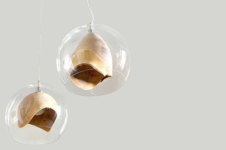 elegant teca lamp combines raw woodturning with glass enclosure - designboom | architecture