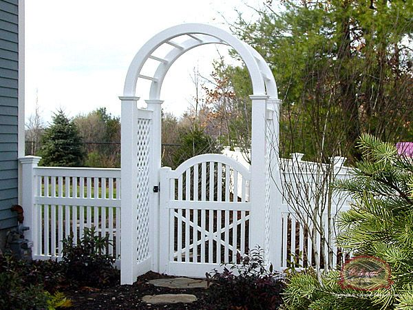white picket fence with arbor -  By garage separating the far back yard