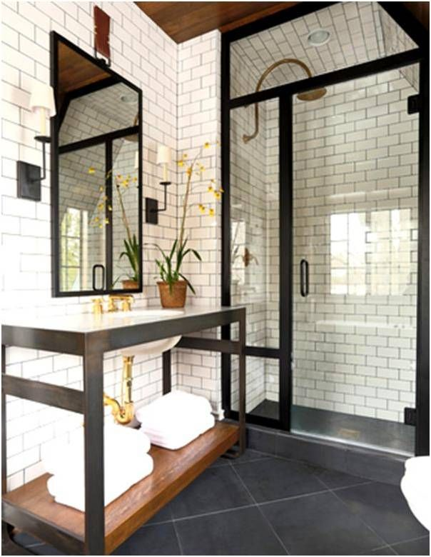 Love the all white bathroom and shower tile  with bronze hardware and wood ceiling