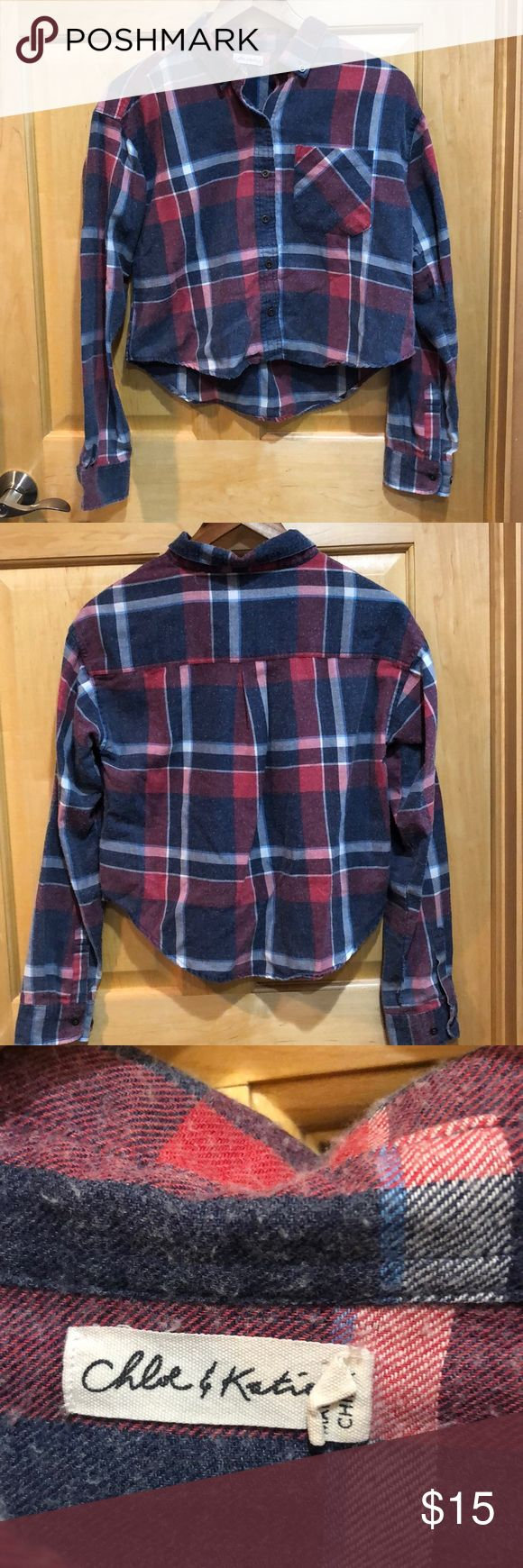 Chloe & Katie Plaid Flannel Shirt slight crop Red/white/blue flannel shirt. Has a worn, pilling grunge look. Fastened with metallic buttons. 20' front 22' back length. Slight crop. Chest patch pocket. Chloe & Katie Tops Crop Tops