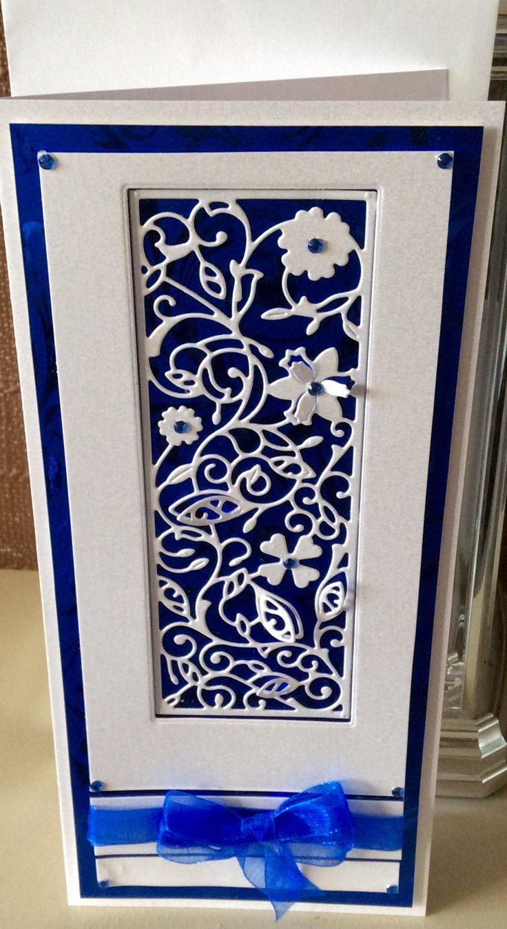 Tattered Lace Card  Made with Blue mirror card & white pearl card.