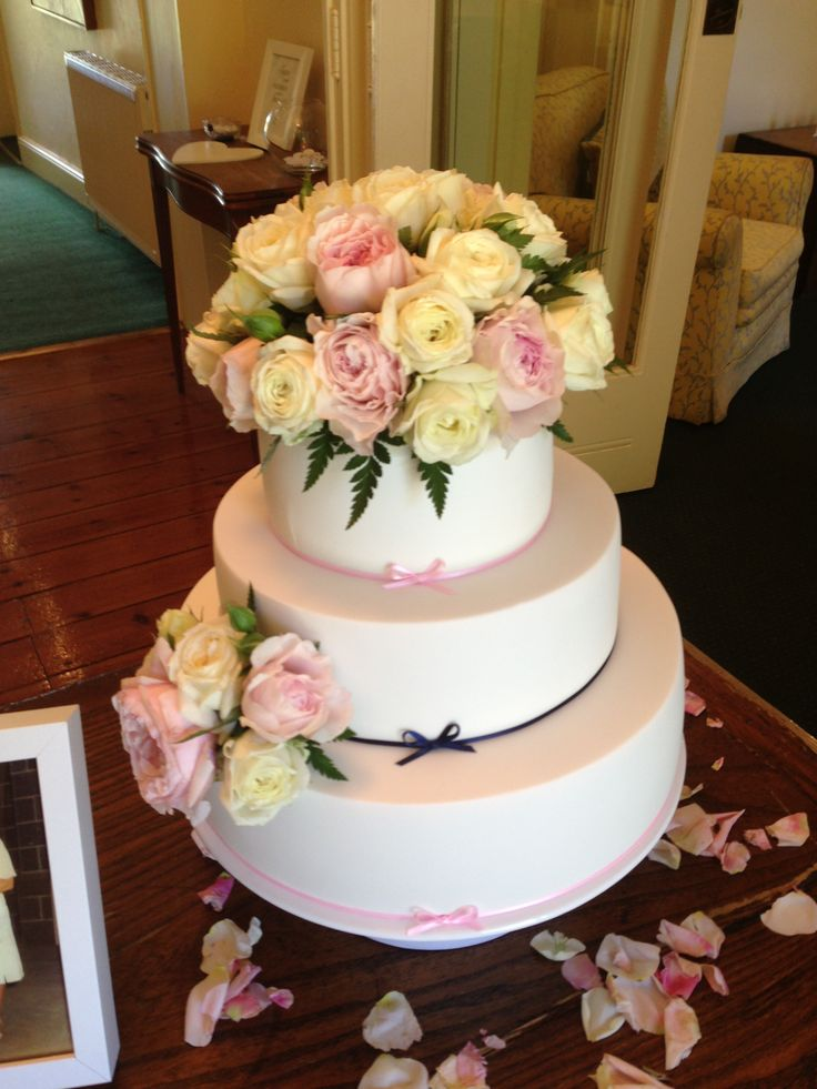 Our wedding cake with pale pink and navy blue ribbon and fresh flowers.  Chocolate mud cake, vanilla buttercream filling, chocolate ganache and fondant. Yum!! So happy with how it turned out