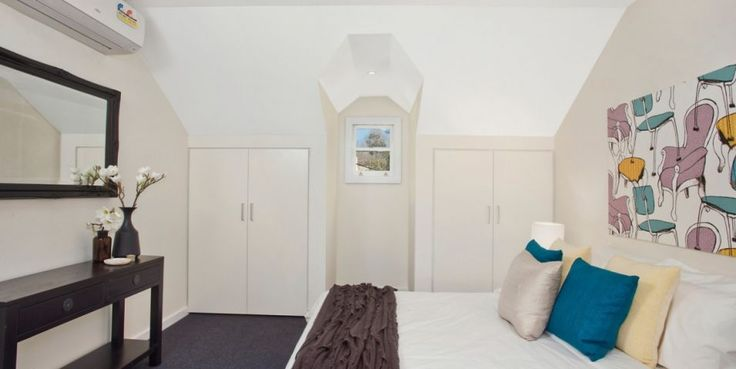 Generous double bedroom, built ins, glass louvres, 100% wool carpet, reverse cycle air con