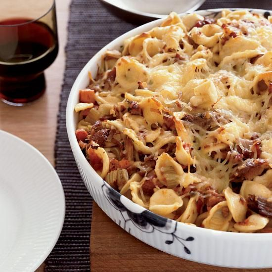Baked Orecchiette with Pork Sugo | Here, chef Ethan Stowell prepares a pork sugo, or rich gravy, by braising pork shoulder until it almost falls apart, shredding it in a food processor and mixing it with a red-wine-and-tomato sauce. He then bakes it with orecchiette under a topping of Parmigiano cheese until crispy. The dish is an excellent alternative to the usual baked pasta, because it's not as heavy and cheesy but still delicious and satisfying.