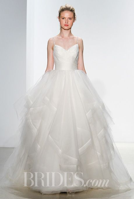 Brides.com: . V-neck wedding dress with beaded spaghetti straps and tiered tulle skirt, Kelly Faetanini