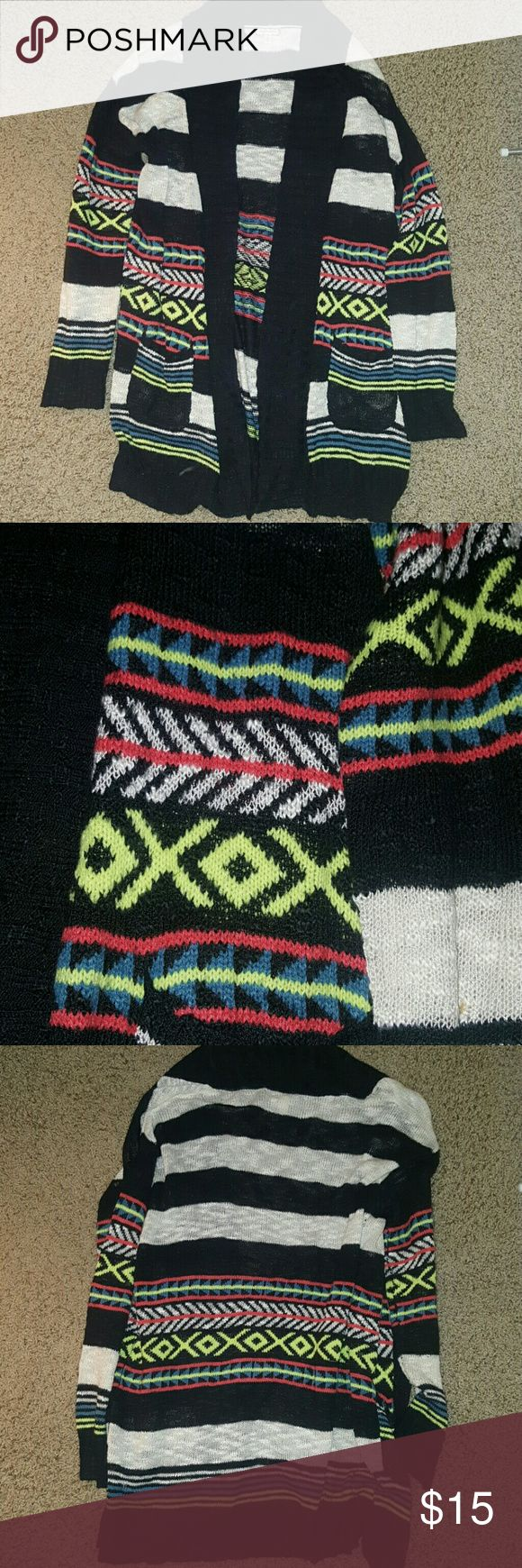Tribal print cardigan This cardigan has a fun neon green, pink, blue, cream and black tribal print with stripes combo. It is also long and flowy. Super cute for any season! Sweaters Cardigans