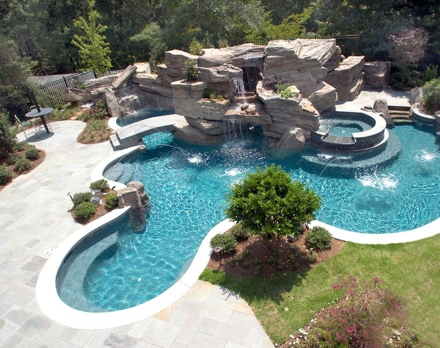 Elaborate Pool Featuring Large Grotto, Waterfall And Tube Slide. Nothing  Quite Like A Water Park In Your Backyard.