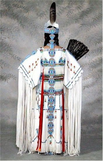 Beautiful, stunning!  White buckskin dress with hand beading, hair pipe bone chest and back piece, amazing  crown and tail.