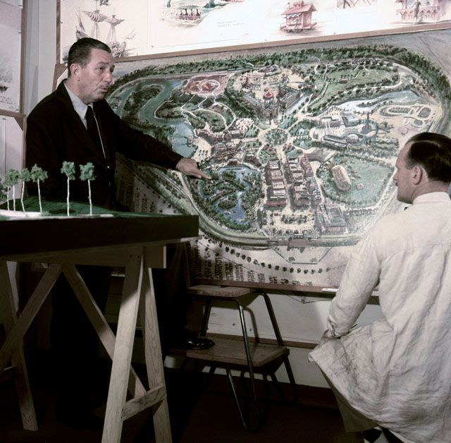 Walt Disney stands by a plan of Disneyland and chats with an imagineer circa 1954 in Los Angeles. (Earl Theisen/Getty Images)