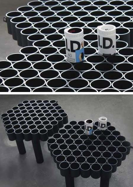 Those aren't coffee mugs, they're magazines rolled up. Just cut hard plastic tubing, glue together, with four of them left long enough to use as legs. Works great in doctor offices too.