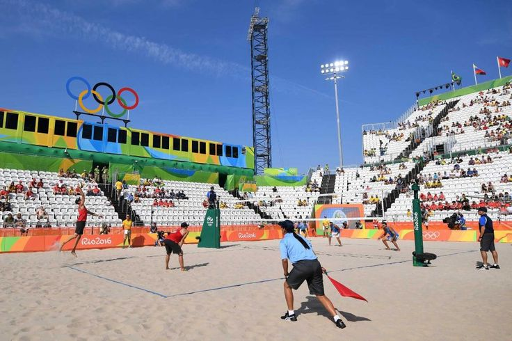 Austria's Clemens Doppler (L) serves the ball during the men's beach volleyball qualifying match between Italy and Austria at the Beach Volley Arena in Rio de Janeiro on August 6, 2016, for the Rio 2016 Olympic Games.
