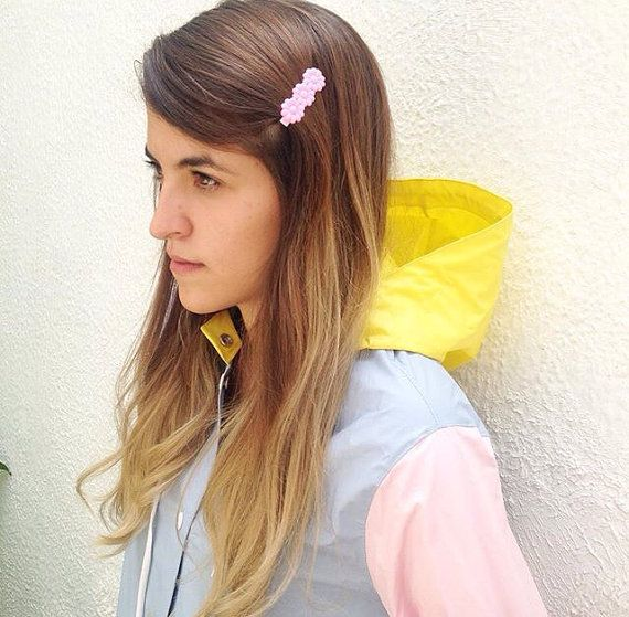 SHIPPING TAKES 4 WEEKS TO ARRIVE WORLDWIDE FROM THE DATE OF SHIPPING NOT BEFORE, FASTER OPTIONS ARE AVAILABLE AT EXTRA COST CONTACT US FOR RATES.  Handmade Pastels colorblock Plastic Raincoat Mac. Pink sleeves, yellow and baby blue pastel colors One size. If you need more info and pictures of this item please contact us. Details:  .-Made in pvc with cotton bias seams .-Unlined .-Metallic blue press buttons for closures .-Hoodie .-Large front pockets .-Regular Fit  Dimensions:  *Small Size…