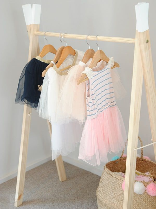 Our Simply Child A-Frame white dipped clothes rail is a contemporary alternative for your little one's clothing rail. The rail is great for storing dress up's or your kid's favourite outfits. The open design of this clothes rack makes it easy for your child to pick out their clothes and is the perfect height for little one.The rail packs flat, assembly is straight forward & instructions are included.Hand made by Simply Child in pine wood.Lead time: Ships within 1-2 weeksDimension...