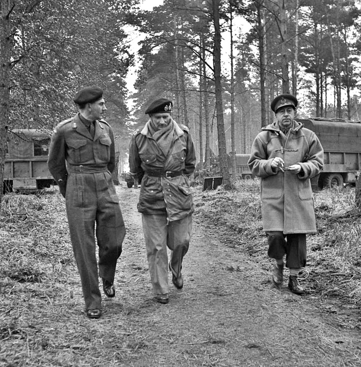 Field Marshal Montgomery takes a stroll in a German forest in the company of Canadian generals Crerar (right) and Simonds, early 1945.