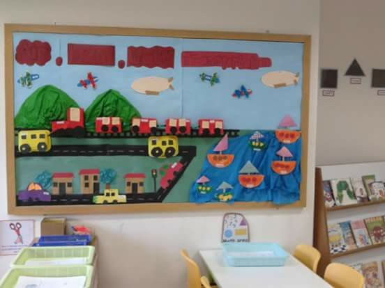 The theme is Transportation. So on this board the nursery kids made some beautiful artwork from recycle styrofoam, milk box and paper plate to give the 3D touch. For water and the mountain, i used the crepe paper.