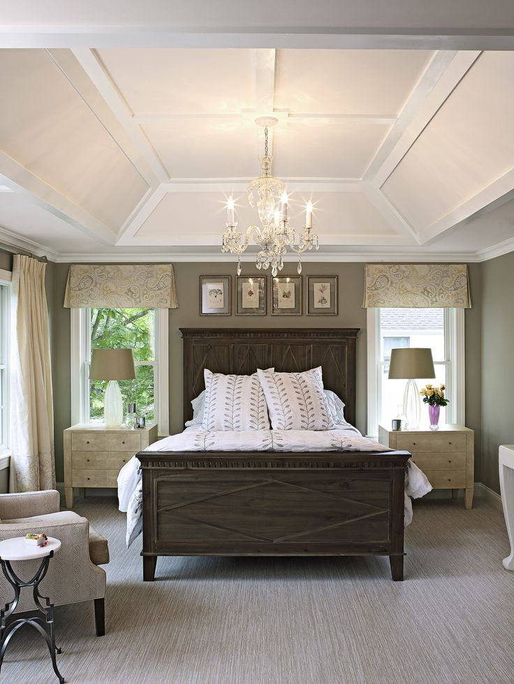 A lofty tray ceiling, soft neutrals and white trim create a sense of luxury and serenity in this master bedroom suite.