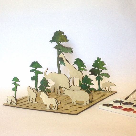 These Laser Cut wood toys depict animal sceens. by Base9Designs
