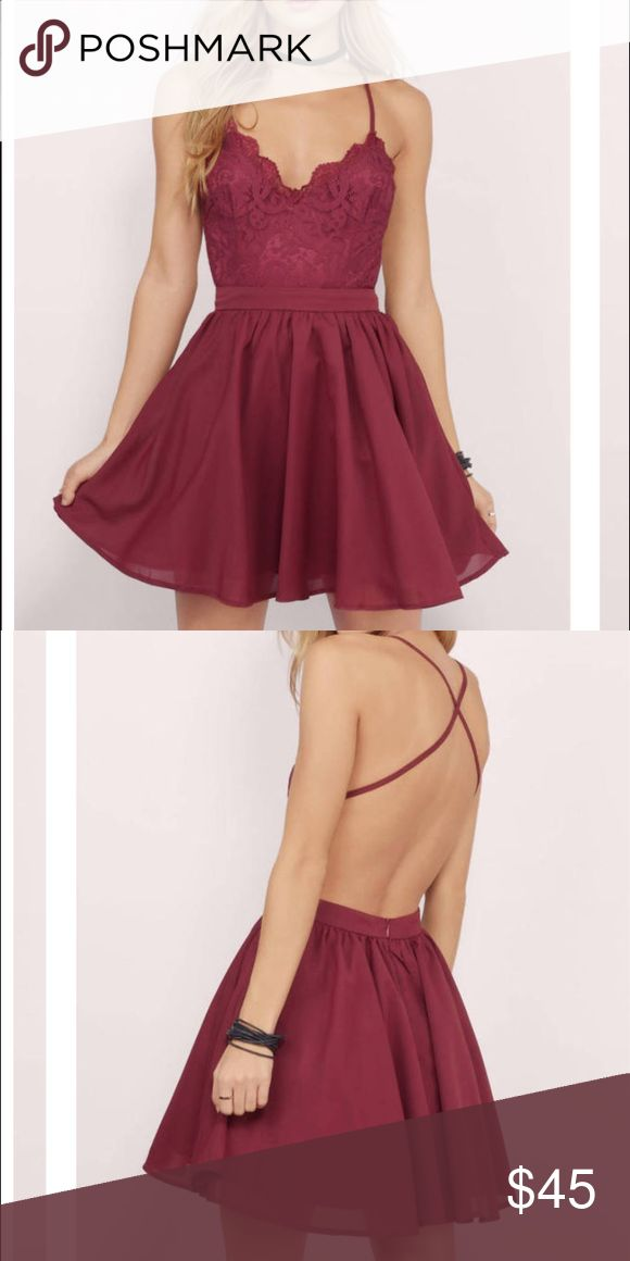 Burgundy Tobi Mila Skater Dress - Size M New with tags and still in the package! Perfect dress for a holiday party or semi-formal event! Very flattering! Tobi Dresses Backless