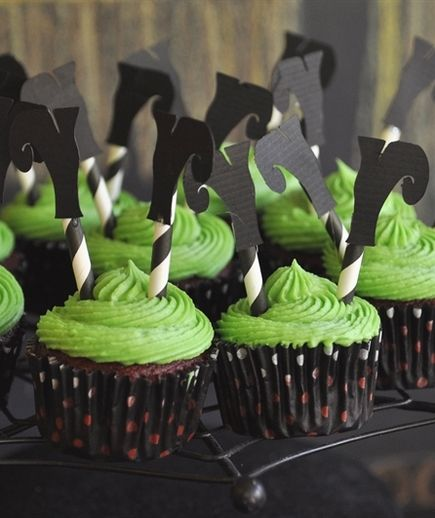Cut boots out of black construction paper and snip a striped paper straw in half. Affix a boot to each half of the straw and stick them both in the cupcakes for a cute topper that symbolizes the downfall of the wicked witch.
