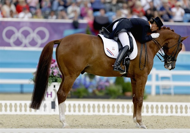 Adelinde Cornelissen of the Netherlands pats Parzival after competing in the equestrian dressage competition - Silver medal #OS2012