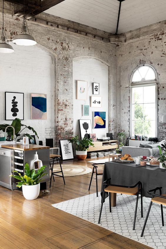 Spaces with high ceilings are better suited for an eclectic jumble of artwork and furniture, which would feel crowded in a more cramped environment.