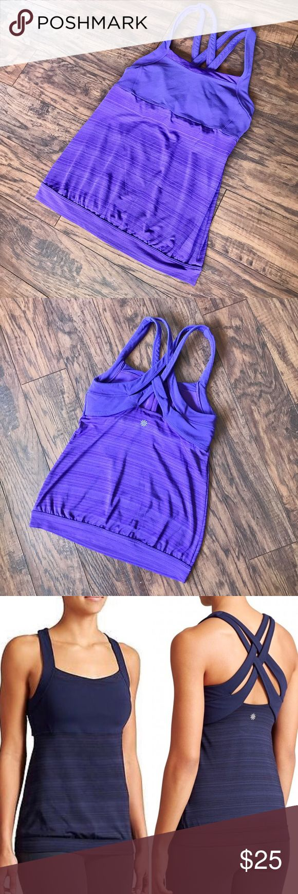 Athlete Purple Workout Tank A strappy and supportive workout Tank from Athleta. Great for yoga or the gym. Cross-cross straps in back. The color is purple, but I included the navy stock photo so you can see what it looks like on. I love this top and wish it fit me! Athleta Tops Tank Tops